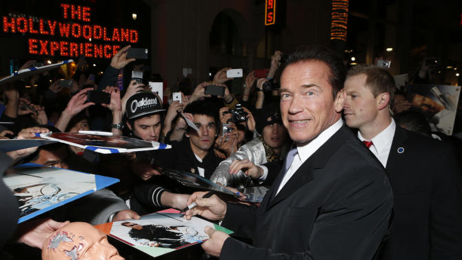 """Arnold Schwarzenegger attends the LA premiere of """"The Last Stand"""" at Grauman's Chinese Theatre on Monday, Jan. 14, 2013, in Los Angeles. (Photo by Todd Williamson/Invision/AP)"""