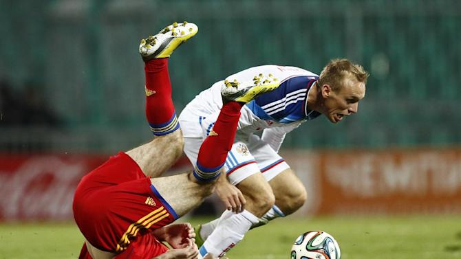 Russia's Denis Glushakov, right, competes for a ball with Armenia's Karlen Mkrtchyan during international friendly soccer match in Krasnodar, Russia, Wednesday, March 5, 2014. Russia won 2-0