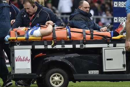 England's Brown is transported during their Six Nations Championship rugby union match against Italy at Twickenham in London