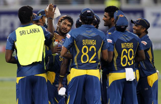 Sri Lanka's Kumar Sangakkara (C) celebrates with his team mates after taking a catch to dismiss Pakistan's Shahid Afridi during their second Twenty20 international cricket match in Dubai
