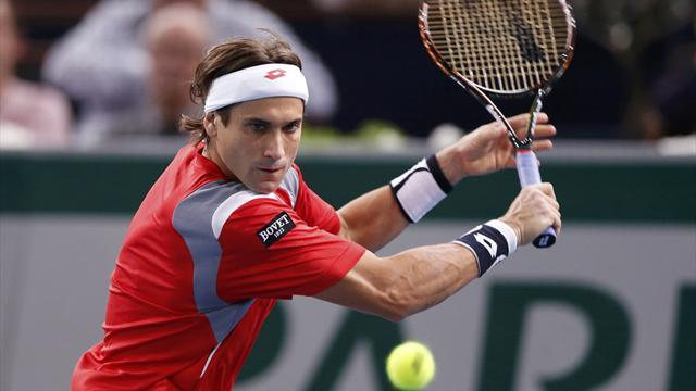 Tennis - Ferrer fights back to reach quarters in Auckland