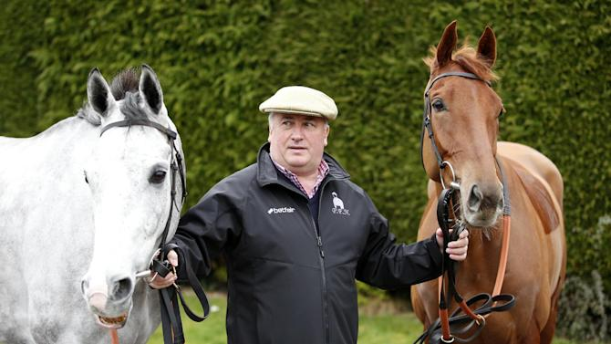 Trainer Paul Nicholls with Politologue (L) and Movewiththetimes (R) during the stable visit