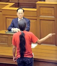 Leung Kwok-hung (standing) shouts at Chief Executive Donald Tsang during the leader's annual policy address in the Hong Kong Legislative Council chamber in 2008. Leung's activism has landed him in jail four times, and a new conviction, handed down in March for disorderly behaviour
