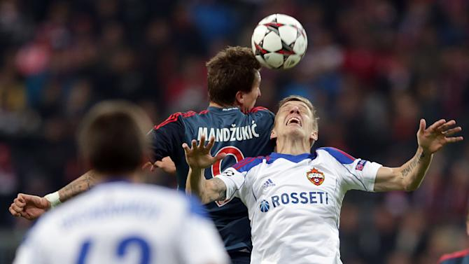 Moscow's Pontus Wernbloom, right, and Bayern's Mario Mandzukic of Croatia challenge for the ball during their Champions League first round group D soccer match between FC Bayern Munich and CSKA Moscow, in Munich, Germany, Tuesday, Sept. 17, 2013