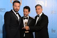 """(L-R) Actor-director Ben Affleck and producers Grant Heslov and George Clooney with the award for best motion picture drama for """"Argo"""" at the Golden Globe awards on January 13, 2013. """"Argo"""" won the top two Golden Globes last weekend and is nominated for seven prizes at next month's Academy Awards"""