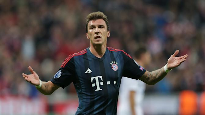 Bayern's Mario Mandzukic of Croatia celebrates after scoring his side's second goal during the Champions League first round group D soccer match between FC Bayern Munich and CSKA Moscow, in Munich, Germany, Tuesday, Sept. 17, 2013