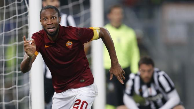 AS Roma's Keita celebrates after scoring against Juventus during their Italian Serie A soccer match at the Olympic stadium in Rome