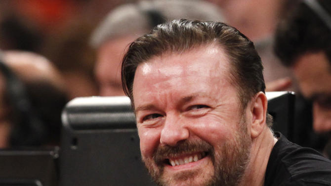 Comedian Ricky Gervais attends an NBA basketball game between the Miami Heat and the New York Knicks Saturday, Feb. 1, 2014, in New York. Miami won 106-91. (AP Photo/Jason DeCrow)
