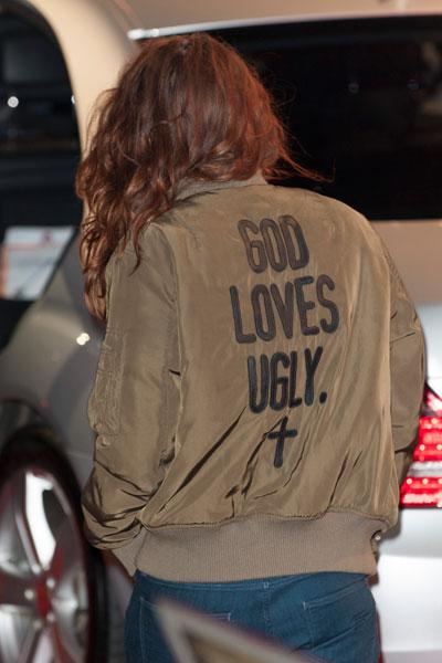 "With her back to the cameras, Stewart's jacket reads ""God Loves Ugly."" Picture by: Reimschuessel / Splash News"