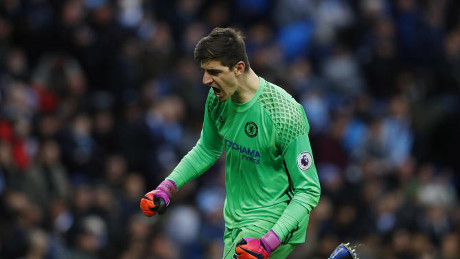 Chelsea's Thibaut Courtois celebrates their second goal scored by Willian