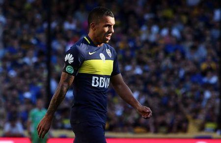 Boca Juniors' Tevez wears an arm band with the logo of Brazilian soccer team Chapecoense during a match to pay tribute to the victims of the plane crash in Colombia in Buenos Aires