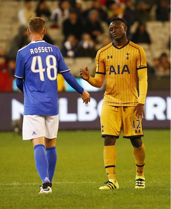 Juventus' Lorenzo Rosseti shakes hands with Tottenham's Victor Wanyama at the end of the match