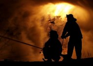 Russian firefighters try to extinguish a blaze in the northern port of Arkhangelsk in November 2011. Seven people were killed and eight others were injured when a major fire broke out at an industrial waste treatment plant in Russia's oil-rich north, the emergencies ministry says