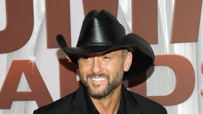 "FILE - In this Nov. 9, 2011 file photo, country singer Tim McGraw arrives at the 45th Annual CMA Awards in Nashville, Tenn.   McGraw announced Tuesday, Oct. 20, 2012, that his first album on Big Machine Records, ""Two Lanes of Freedom,"" will be released Feb. 5, 2013.  The new single ""One of Those Nights"" will debut on ABC's live broadcast of the 2012 CMA Awards on Thursday. (AP Photo/Evan Agostini, file)"