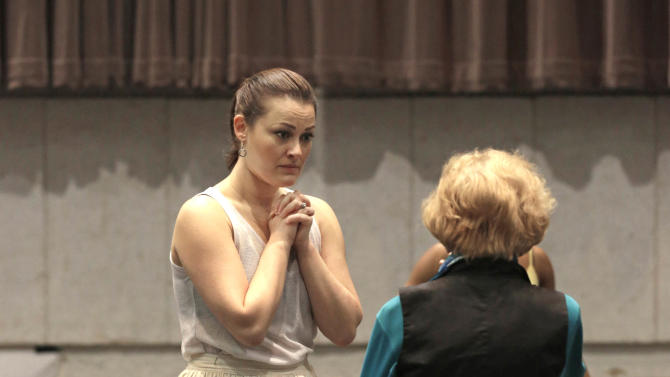 "In this April 26, 2013 photo, choreographer Gemze de Lappe, right, talks with leading lady, Ashley Brown, who portrays Laurey, during a rehearsal of Rodgers and Hammerstein's ""Oklahoma!"" at the Lyric Opera of Chicago. De Lappe first danced in ""Oklahoma!"" in 1943 as a member of the Broadway hit's first national touring company and now 70 years later at age 91 she's choreographing a production of the musical at the Lyric. (AP Photo/M. Spencer Green)"