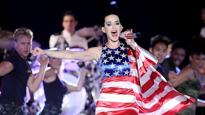 "FILE - In this May 23, 2012 file photo released by Starpix, singer Katy Perry wears a patriotic dress as she performs at a Pepsi-sponsored event at Brooklyn Pier 9A, kicking off  Fleet Week in New York. Perry's ""Wide Awake,"" was the top downloaded song on iTunes for the week ending July 9, 2012.  (AP Photo/Starpix, Amanda Schwab, file)"