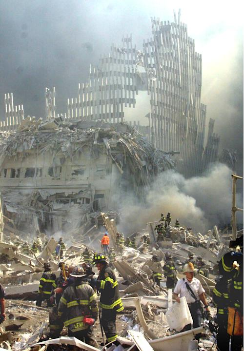 FILE - In this Sept. 11, 2001 file photo, a shell of what was once part of the facade of one of the twin towers of New York's World Trade Center rises above the rubble that remains after both towe