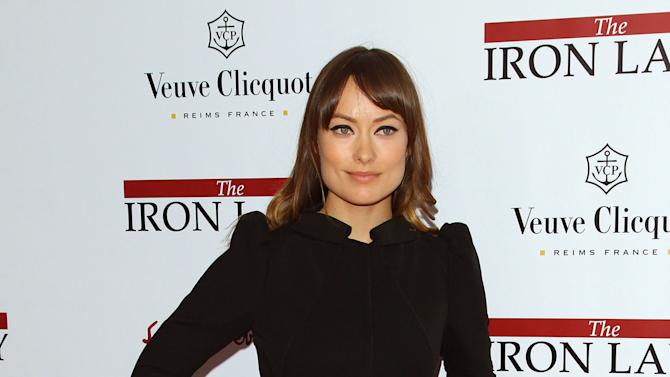 "Actress Olivia Wilde attends the premiere of ""The Iron Lady"" at the Ziegfeld Theater on Tuesday, Dec. 13, 2011, in New York. (AP Photo/Peter Kramer)"