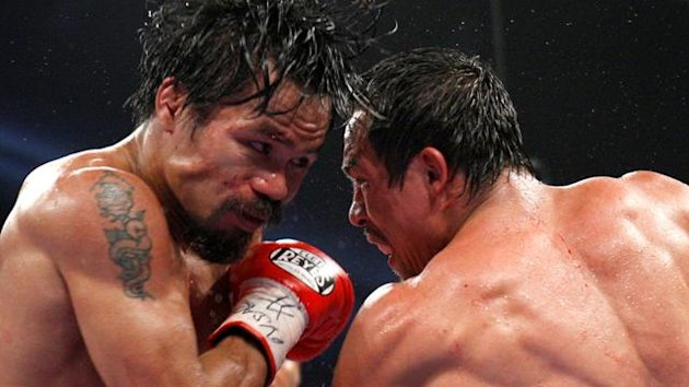 Manny Pacquiao (L) of the Philippines fights against Juan Manuel Marquez of Mexico during their WBO welterweight fight at the MGM Grand Garden Arena in Las Vegas, Nevada