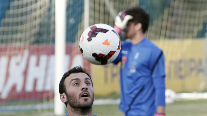 Greece's Vassilis Torosidis controls the ball during a training session in Athens, Monday, Oct. 14, 2013, ahead of their 2014 World Cup Group G qualifying match against Liechtenstein on Tuesday