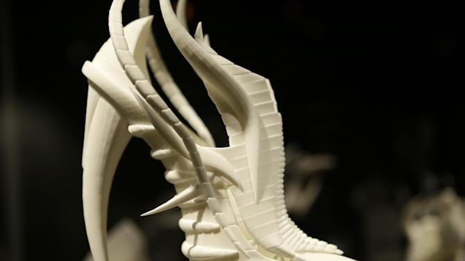 """This Feb. 11, 2013 photo shows Janina Alleyne's """"Exoskeleton"""" shoe on display at the """"Shoe Obsession"""" exhibit at The Museum at the Fashion Institute of Technology Museum in New York. The exhibition, showing off 153 specimens, runs through April 13. (AP Photo/Kathy Willens)"""