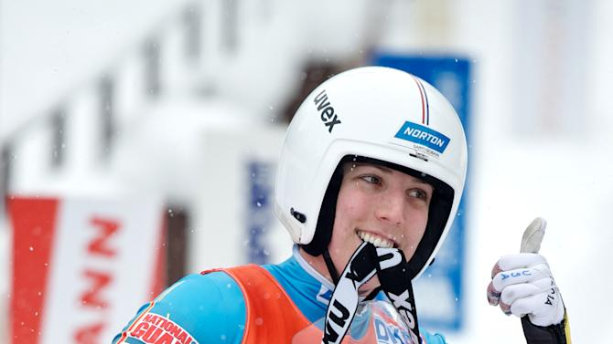 Erin Hamlin of the US gestures after placing third in the womens luge World Cup event in the Latvian town of Sigulda on February 19, 2012. AFP PHOTO /ILMARS ZNOTINS (Photo credit should read ILMARS ZNOTINS/AFP/Getty Images)