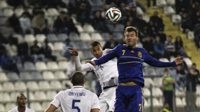 Ukraine's Tymoshchuk jumps for the ball Brooks of the U.S. during their international friendly soccer match in Larnaca