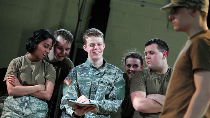 """In this photo provided by the National Theatre Wales, on Friday April 20, 2012  Matthew Aubrey,center, plays U.S. Army Pfc. Bradley Manning in the play """"The Radicalization of Bradley Manning.""""  To some he's a traitor to his country, to others a free-speech hero.  But before he was a public enemy or a cause celebre, U.S. soldier and alleged WikiLeaks source Bradley Manning was a high-school student in west Wales  a pivotal period that is the subject of a new British play.(AP Photo/ Farrows Creative / National Theatre Wales)"""