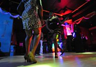 Women dance in a nightclub in Bangui, Central African Republic, on January 3, 2013. In Bangui, nightclubs have become dayclubs because of a curfew in place across the city due to a rebel advance