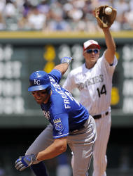 Colorado Rockies second baseman Mark Ellis (14) catches the ball as Kansas City Royals Jeff Francoeur, front, is caught in a rundown between second and third base in the third inning of an interleague baseball game in Denver on Sunday, July 3, 2011. (AP Photo/Chris Schneider)