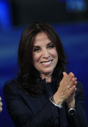 """FILE - In this April 14, 2012 file photo, Olivia Harrison, the widow of George Harrison, former member of The Beatles attends the Italian State RAI TV program """"Che Tempo che Fa"""", in Milan, Italy. George Harrison's widow Olivia hopes to add a more personal side to the reticent Beatle with her new multi-touch book. Based on the documentary, """"George Harrison: Living in the Material World,"""" the book is available Tuesday, May 1, on the iTunes bookstore. It includes audio, video material from the film along with personal photographs, letters, and memorabilia never seen by the public. (AP Photo/Luca Bruno, file)"""