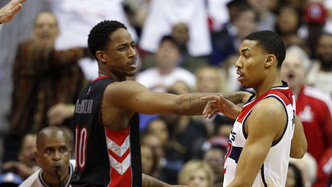 Toronto Raptors guard DeMar DeRozan (10) shoves Washington Wizards forward Otto Porter Jr. during the second half of Game 3 in the first round of the NBA basketball playoffs Friday, April 24, 2015, in Washington. DeRozan was charged with a technical foul. The Wizards won 106-99. (AP Photo/Alex Brandon)