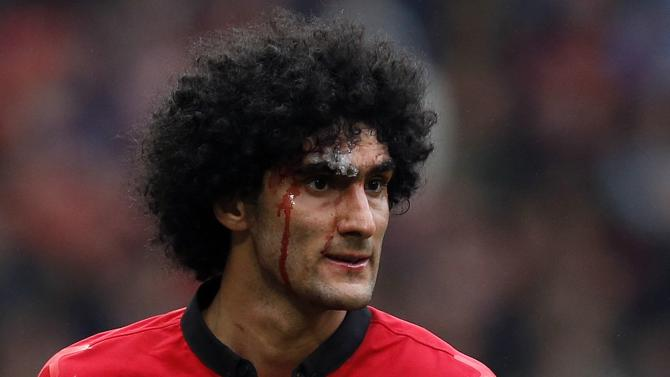 Manchester United's Fellaini bleeds from a head injury during their English Premier League soccer match against Liverpool in Manchester