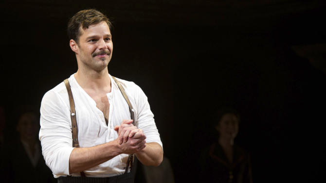 """FILE - This March 12, 2012 file photo shows Ricky Martin at the curtain call after his first performance in the new Broadway production of """"Evita"""", in New York. Martin's career started when he was a child and it has since taken him to practically every stage around the world. But now in New York, the Puerto Rican pop star feels so much at home that he can't imagine moving for a while. """"I would love to do Broadway the rest of my life,"""" Martin said Tuesday, July 17, 2012 breaking a months-long silence he subjected himself to in order to preserve his voice, which he's been using eight shows a week as Che in """"Evita"""" since March and until next January. (AP Photo/Charles Sykes, file)"""