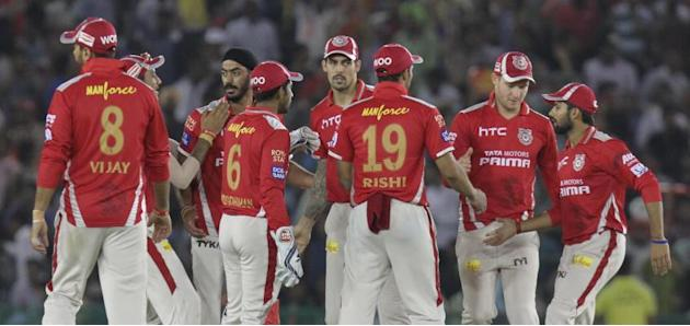 Mohali: Kings XI Punjab players celebrate fall of a wicket during an IPL-2015 match between Sunrisers Hyderabad  and Kings XI Punjab at  Punjab Cricket Association Stadium in Mohali, Punjab on April 2