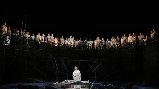 This June 16, 2013 photo released by the San Francisco Opera is Sasha Cooke as Mary Magdalene with the San Francisco Opera chorus in the background in the summer opera, The Gospel of Mary Magdalene, in San Francisco. (AP Photo/San Francisco Opera, Cory Weaver)