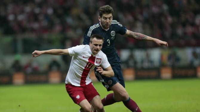 Poland's Slawomir Peszko and Charlie Mulgrew of Scotland fight for the ball during their international friendly soccer match in Warsaw