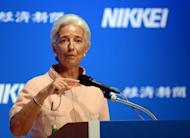 International Monetary Fund (IMF) chief Christine Lagarde delivers a speech at the Nikkei Special Forum at a hotel in Tokyo. Lagarde has warned that the global economy was slowing, with a soon-to-be published growth outlook lower than earlier forecasts