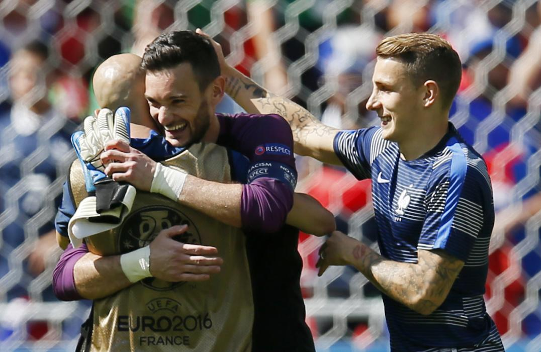 France's Hugo Lloris and Lucas Digne (R) celebrate after the game