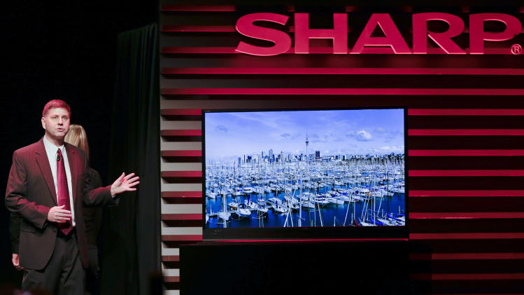 Sharp Electronics vice president for strategic product marketing Jim Sanduski, introduces the ICC Purios Ultra HD resolution Panel at a news conference during press day at the Consumer Electronics Show,  Monday, Jan. 7, 2013, in Las Vegas. (AP Photo/Julie Jacobson)