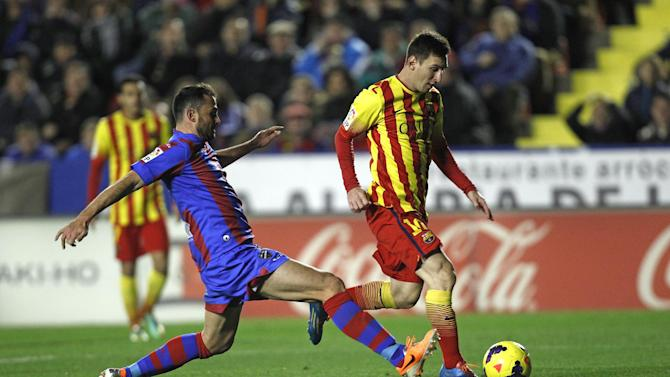 Barcelona's Lionel Messi from Argentina duels for the ball with Levante's Vyntra from the Czech Republic during their La Liga soccer match at the Ciutat de Valencia stadium in Valencia, Spain, Sunday, Jan. 19, 2014