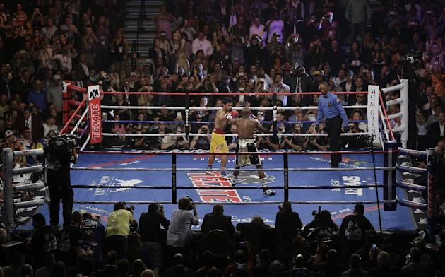 Floyd Mayweather Jr., right, and Manny Pacquiao, from the Philippines, trade punches during their welterweight title fight on Saturday, May 2, 2015 in Las Vegas. (AP Photo/Eric Jamison)