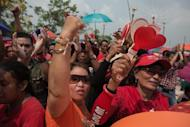 "Thai pro-government ""Red Shirts"" shout slogans during a rally at Phutthamonthon, suburb of Bangkok on April 6, 2014"