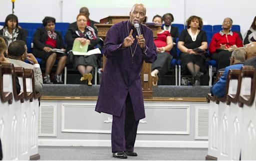 In this photo taken on Sunday, Feb. 8, 2015, Pastor Kent O. Johnson preaches to the congregation at Washington Street Missionary Baptist Church in Paducah, Ky. The church celebrated it's 160th anniversary over the weekend.  Johnson was the church's 16th pastor. (AP Photo/The Paducah Sun, Ellen O'Nan)