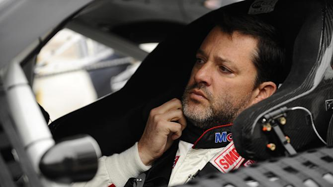 Tony Stewart prepares to start the NASCAR Sprint Cup series auto race at Texas Motor Speedway Monday, April 7, 2014, in Fort Worth, Texas. Stewart starts on the pole in the race which was postponed a day because of rain