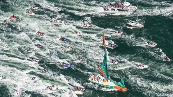 Groupama Sailing Team, skippered by Franck Cammas from France, are followed in by a huge fleet of spectator boats, after claiming victory in the Bretagne In-Port Race during the Volvo Ocean Race June 30,
