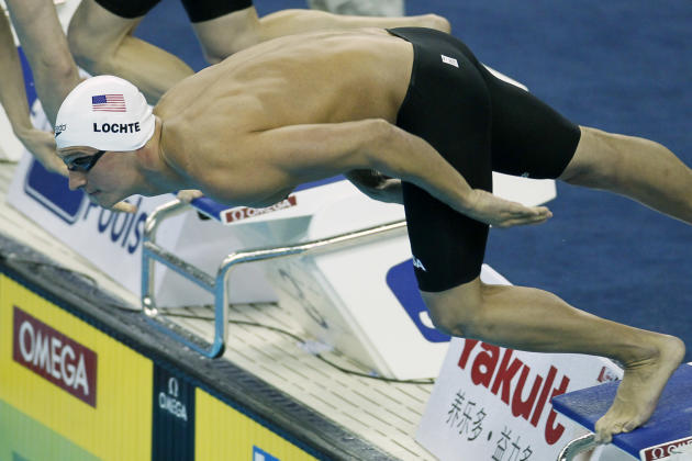 U.S. Ryan Lochte dives in to start his men's 200m Individual Medley heat at the FINA Swimming World Championships in Shanghai, China, Wednesday, July 27, 2011. (AP Photo/Eugene Hoshiko)