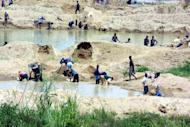 File photo of a diamond mine outside Freetown, Sierra Leone. Blood diamonds were once the scourge of African nations used to fund years of brutal civil wars. Now a UN-mandated watchdog aims to stop gem greed from fueling more violence in trouble spots