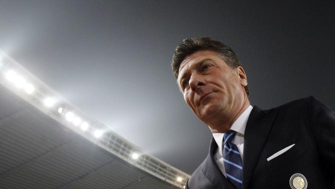 Inter Milan's coach Mazzarri looks on as he arrives on the pitch before the Italian Serie A soccer match against Hellas Verona in Verona