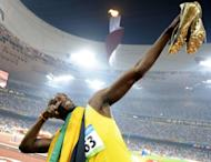 "Jamaican track star Usain Bolt, pictured in 2008, on Thursday acknowledged he has had a rocky build-up to the London Olympics, but declared himself ""ready to go"" in his bid to defend his double sprint titles"